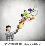 young boy splashing colorful... | Shutterstock . vector #217323070