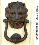 An Old Rusty Lion Head Door...