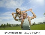 happy father with daughter on... | Shutterstock . vector #217344244