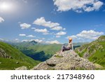 a woman sits on the edge of the ... | Shutterstock . vector #217348960