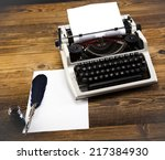 typewriter and a blank sheet of ... | Shutterstock . vector #217384930