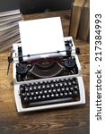 typewriter and a blank sheet of ... | Shutterstock . vector #217384993