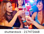 happy girls toasting with... | Shutterstock . vector #217472668