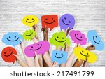 hands holding smiley faces... | Shutterstock . vector #217491799