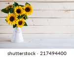 Sunflowers In A Vase On A...