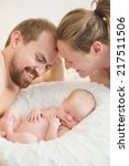 young parents with newborn baby | Shutterstock . vector #217511506