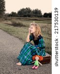 crying girl sitting on the... | Shutterstock . vector #217530139