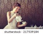 dreamer woman drinking tea at... | Shutterstock . vector #217539184
