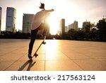 woman skateboarder... | Shutterstock . vector #217563124