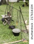 Small photo of Antique cookware in military camp at a reenactment of the American Revolutionary War (1775-1783)