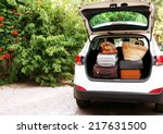 Suitcases And Bags In Trunk Of...