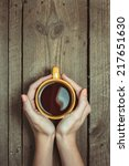female hands holding cup of... | Shutterstock . vector #217651630