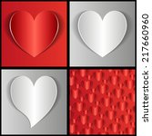paper hearts on a gray and red... | Shutterstock .eps vector #217660960