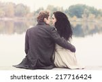 Beautiful Couple Sitting By Th...