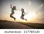 two pretty girls jogging in the ... | Shutterstock . vector #217785130