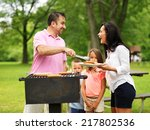 family cookout   dad giving mom ... | Shutterstock . vector #217802536