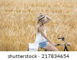 Young Woman With Summer Hat...