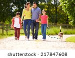 Stock photo hispanic family taking dog for walk in countryside 217847608
