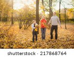 happy family in autumn park... | Shutterstock . vector #217868764