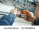 hands of electrician with... | Shutterstock . vector #217868863