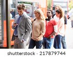 queue of people waiting at bus... | Shutterstock . vector #217879744