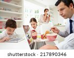 family using digital devices at ... | Shutterstock . vector #217890346