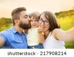 family with little girl in park ...   Shutterstock . vector #217908214