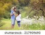 happy pregnant family having... | Shutterstock . vector #217909690