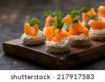 mini canapes with smoked salmon | Shutterstock . vector #217917583