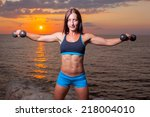 the girl with a sports figure... | Shutterstock . vector #218004010