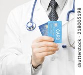 doctor holding credit cards in... | Shutterstock . vector #218005198