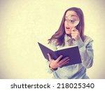 young girl looking through a...   Shutterstock . vector #218025340