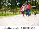hispanic family taking dog for... | Shutterstock . vector #218033518