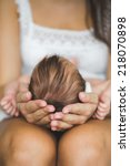 mother holding head of her... | Shutterstock . vector #218070898
