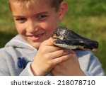 Large Black Snake Held By A Bo...