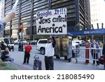 Small photo of NEW YORK CITY - SEPTEMBER 17 2014: Occupy Wall Street marked the third anniversary of its founding as several dozen activists gathered in Zuccotti Park.David Smith with sign denouncing Jewish hegemony