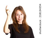 Small photo of Portrait of an attractive beautiful happy young caucasian woman dressed in black t-shirt smiling and gesturing voila by the right hand isolated on white background with empty copy space.
