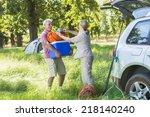 senior couple unpacking car for ... | Shutterstock . vector #218140240