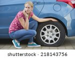 woman with flat tire on car... | Shutterstock . vector #218143756