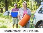 senior couple unpacking car for ... | Shutterstock . vector #218146786
