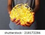 woman holding yellow garland on ... | Shutterstock . vector #218172286