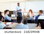 male tutor teaching university... | Shutterstock . vector #218239048