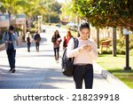 students walking outdoors on... | Shutterstock . vector #218239918