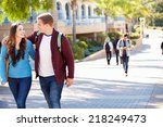 student couple walking outdoors ... | Shutterstock . vector #218249473