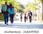 Stock photo student couple walking outdoors on university campus 218249503
