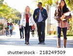 Stock photo students walking outdoors on university campus 218249509