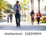 students walking outdoors on... | Shutterstock . vector #218249854