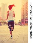runner athlete running on city... | Shutterstock . vector #218256364