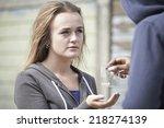 teenage girl buying drugs on...   Shutterstock . vector #218274139