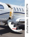 Small photo of BERLIN, GERMANY - MAY 21: Light business jet Embraer EMB-505 Phenom 300 at the International Aerospace Exhibition ILA on May 21nd, 2014 in Berlin, Germany.